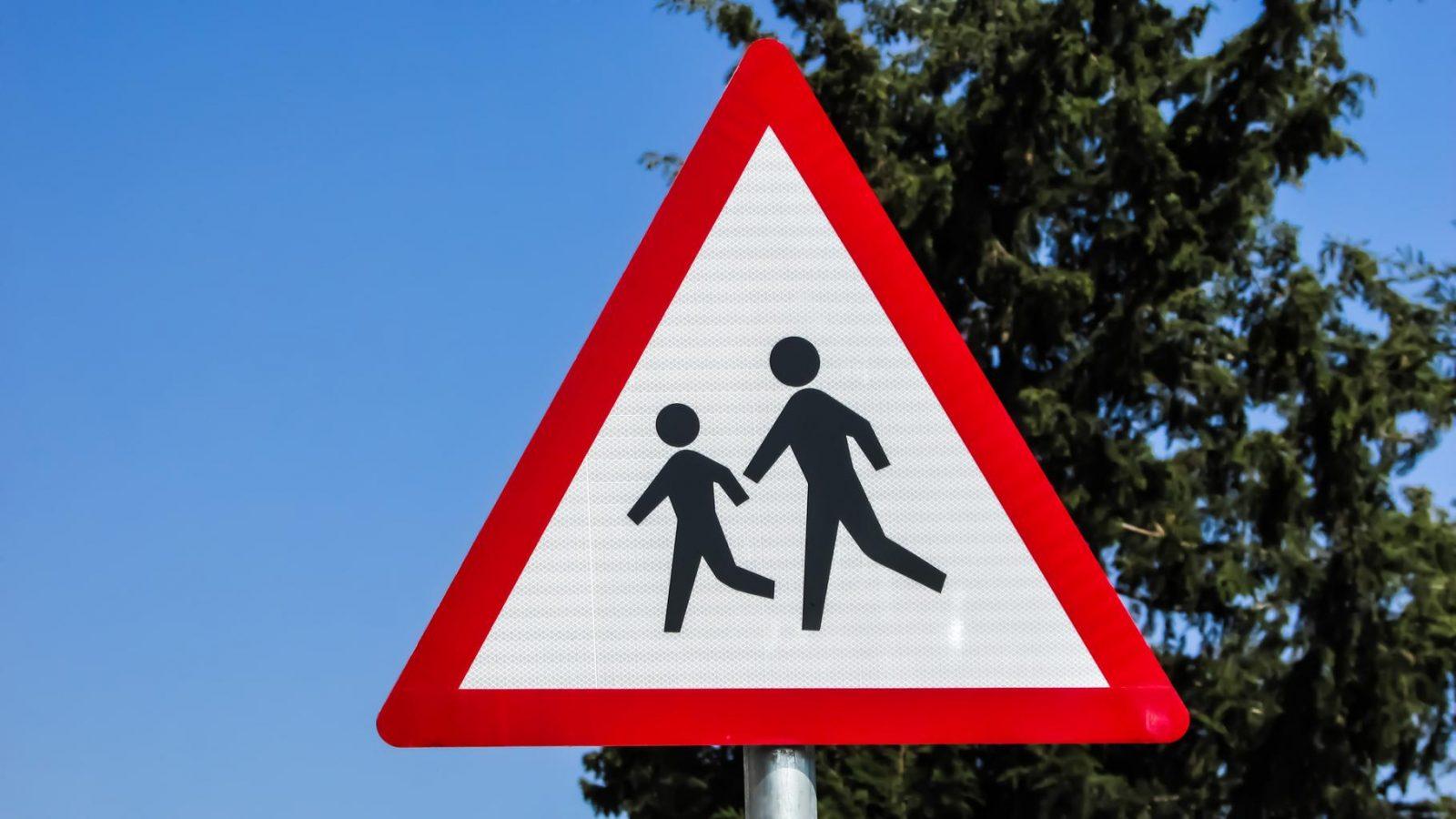 Warning school children crossing